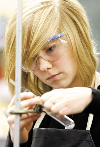 female student in science lab