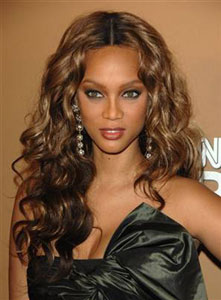 Supermodel Tyra Banks with long, wavy hair
