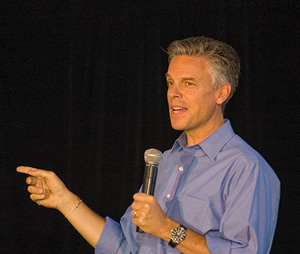 Jon Huntsman Jr on black background