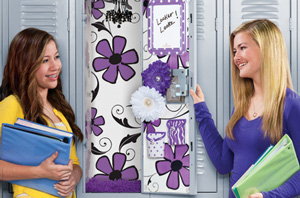two teen girls next to decorated locker