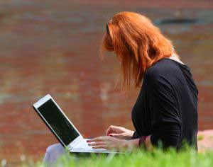 girl working outside on a laptop