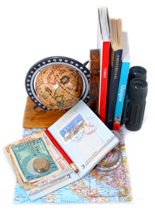 Image of globe, passport, guide book and money