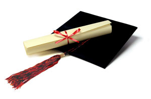 graduation hat and rolled up diploma