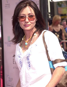 shannen doherty wearing sunglasses and white top