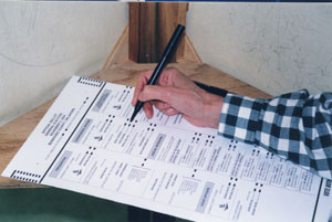 hand filling out a ballot